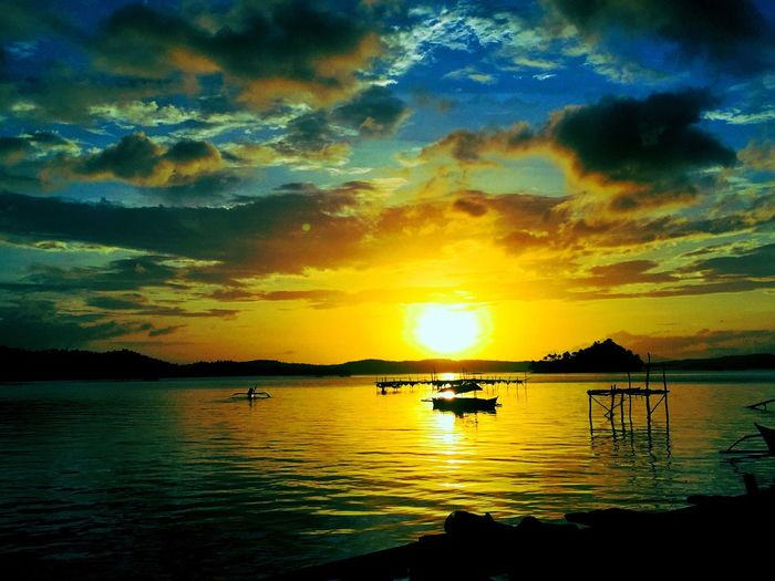 Sunset Water Sky Reflection Beauty In Nature Scenics Tranquility Nature Cloud - Sky Tranquil Scene Nautical Vessel Idyllic Waterfront Silhouette Sea Sun Outdoors Mode Of Transport No People Day Eyeem Philippines Surigao City San Jose Dinagat Island Dinagat Islands