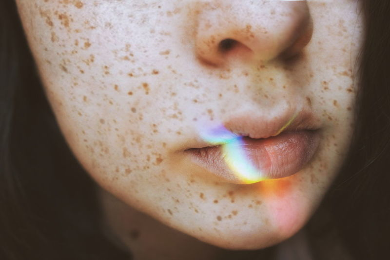 Close-up of spectrum on woman lips