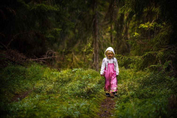 Girl walking in forest