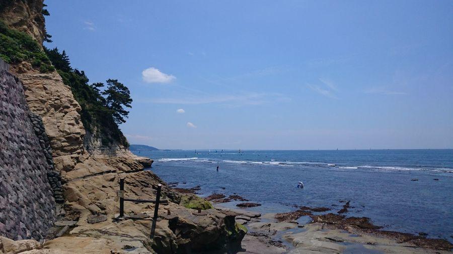 inamuragasaki in Kanagawa.稲村ヶ崎 Sea Beach Water Nature Horizon Over Water Sky Tranquility Outdoors No People Cloud - Sky Day Beauty In Nature Blue Scenics Sand Tree Architecture Wave Inamuragasaki