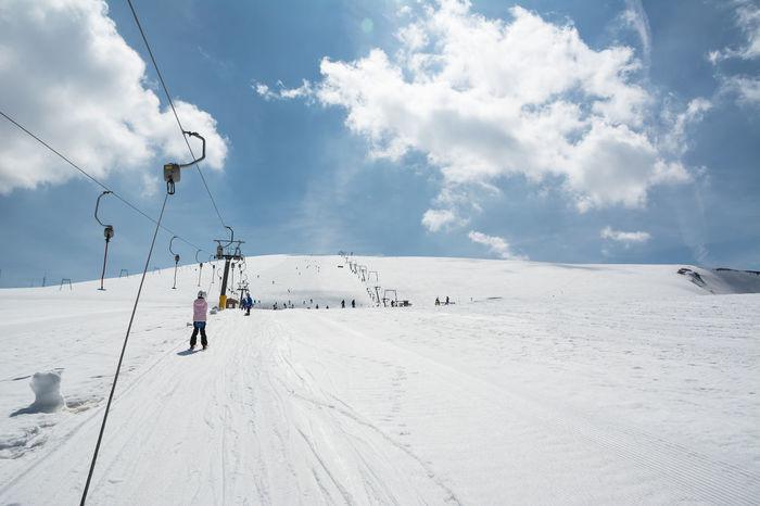 Beginner little girl with skis ascends with ski lift Abruzzo Chairlift Chieti Child Downhill Italy Lift Maiella Majella Mammarosa Pescara Ski Ski Lift Ski-lift Skier Skilift Slope Snow Snowy Sport Uphill Winter