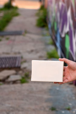 Woman's hand with a tiny canvas in front of an urban background Advertise Canvas Tiny Woman Advertisement Background, City, Design, Dirty, Display Flyer Grungy, Hand, Message Urban Colour Your Horizn