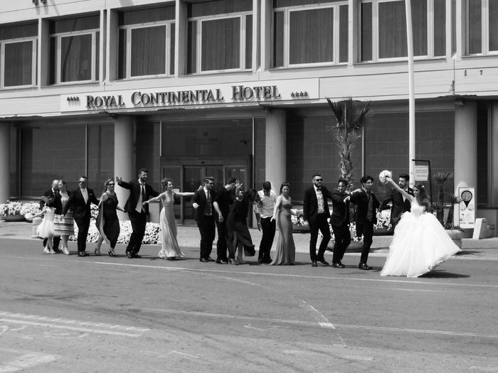 Group of people in front of building