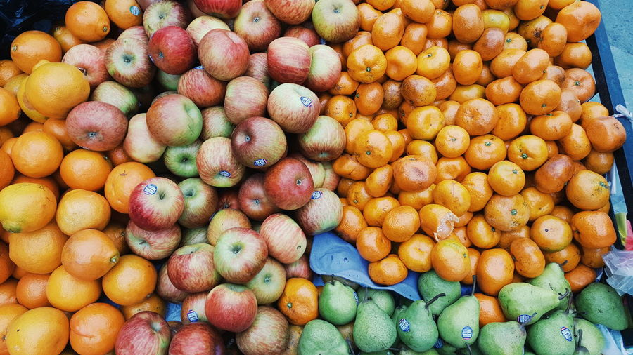 Full Frame Shot Market Abundance Food And Drink Day Food Backgrounds Large Group Of Objects Outdoors No People Close-up Nature Freshness Bananas Apples Tangerine Pear Natural Beauty Colours