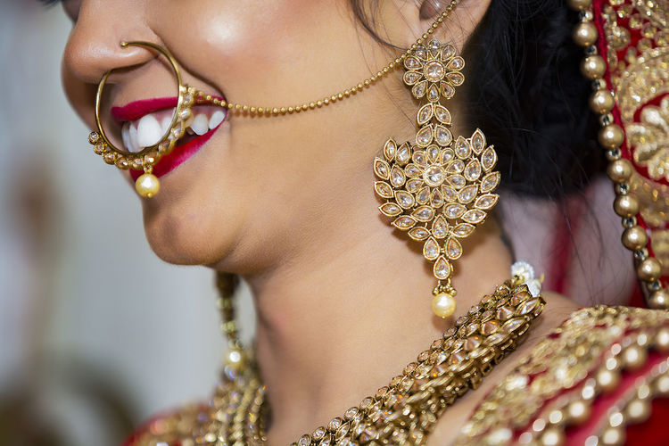 Close-up of bride wearing jewelry