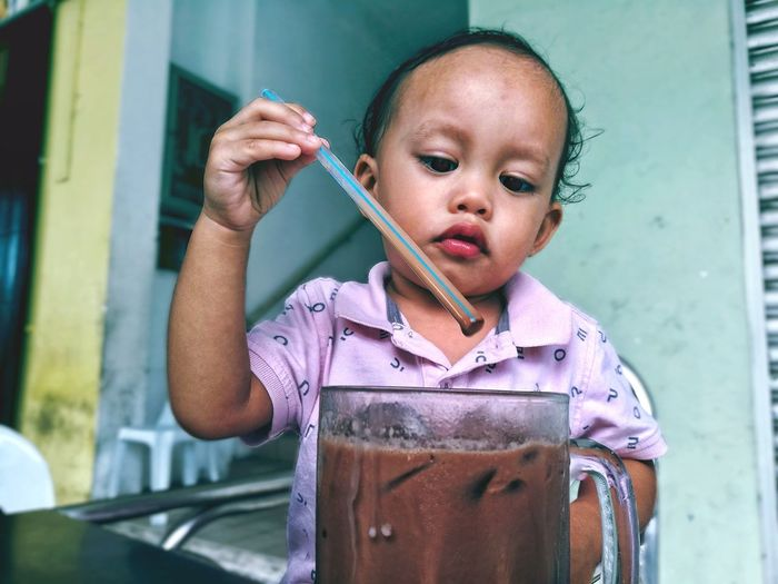 Have a drink Milo Ice Cube Drink Cold Drink Boy Toddler  Kids Children Outside Outdoors Perspective Sunlight Local Potrait Baby Malaysia Delicious People Favorite Sweet EyeEmNewHere Human Hand Child Water Childhood Close-up Posing Drinking Straw Ice Cube