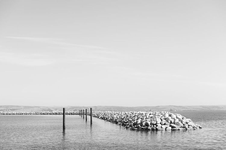 Portland Harbour Water Sea Waterfront Nature Copy Space Scenics - Nature Tranquility Beauty In Nature Tranquil Scene Mooring Post Groyne Travel Holiday Vacations Bw Black And White Outdoors Relaxing Summer Portland Harbour Harbour Conceptual Sunny Dorset Stillness
