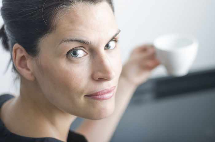 woman is drinking a coffee. Adults Only Beautiful Beautiful Woman Blue Eyes Coffee Coffee - Drink Coffee Cup Cup Delicious Drink Food And Drink Freshness Headshot Holding Indoors  Mug One Person One Woman Only People Portrait Relax Tee White