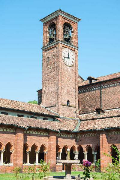 Arch Architecture Blue Building Building Exterior Built Structure Chiaravalle, Milano Clear Sky Clock Clock Tower Clock Towers Day Group Of People History Italy Nature Outdoors Real People Sky The Past Time Tourism Tower Travel Travel Destinations