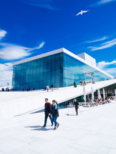 Adult Adults Only Architecture Blue Blue Sky Built Structure Business Day Modern Norway Opera House Oslo Oslo Norway Outdoors People Sky