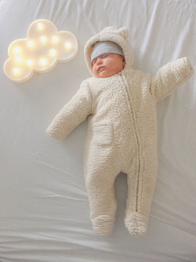 High angle view of cute baby on bed at home