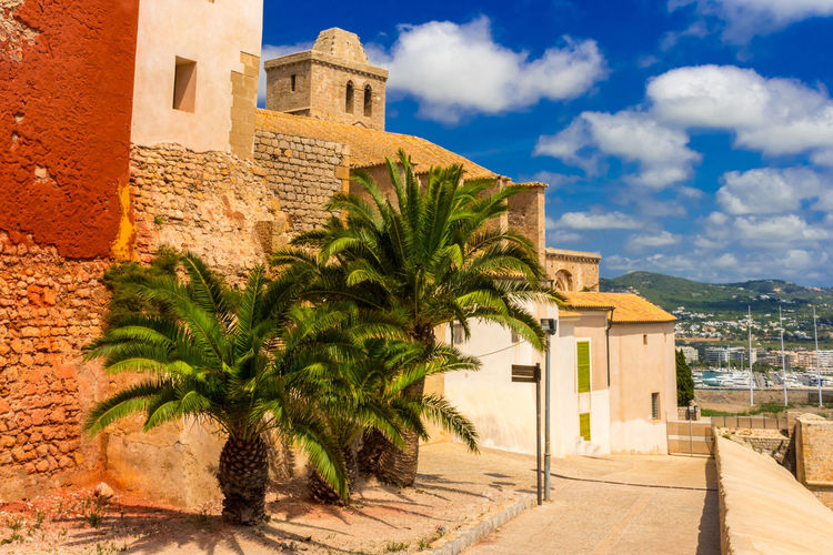 Holiday Ibiza Ibiza, Spain SPAIN Architecture Baleares Balearic Islands Building Building Exterior Built Structure Cloud - Sky Day Go-west-photography.com History House Nature No People Outdoors Palm Tree Plant Sky Summer Sunlight The Past Travel Destinations Tree Tropical Climate Water