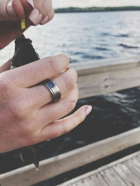 Fish on hook Delicate Hook Fish Fishing EyeEm Selects Human Hand Hand Human Body Part Real People Human Finger Finger Jewelry Women Body Part One Person Ring Lifestyles Close-up Focus On Foreground Water Holding Adult Day