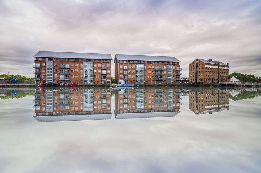 Residential buildings water reflections at sunset in the Docks of Gloucester Architecture Building Building Exterior City City Life Cityscape Cotswolds Docks Gloucester Gloucestershire Industrial Mirror Modern No People Reflection Relaxing Residential Structure Showcase: February Sunset Water Reflections