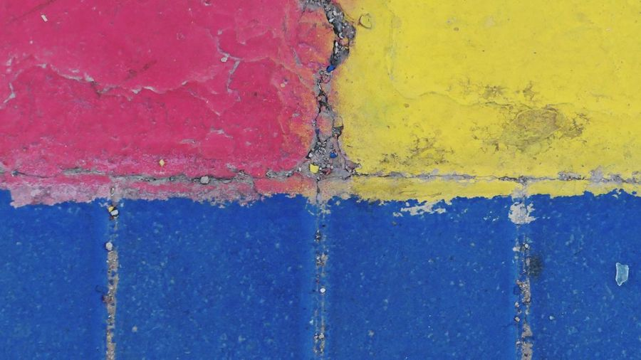Paving Stones City Street Blue Backgrounds Weathered Textured  No People Full Frame Paint Old Pattern Damaged Close-up Multi Colored Day Yellow