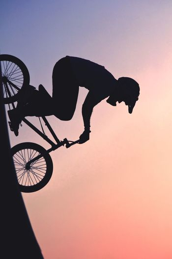 Bmx biker against sunset
