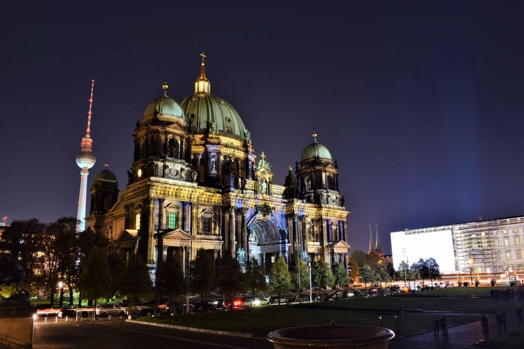 Low angle view of berlin cathedral against sky at night