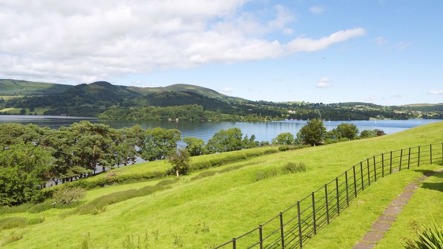 Beautiful peaceful view of Lake Ullswater, Lake District Cumbria with green fields in foreground and Mountains in the background Area Of Outstanding Natural Beauty Blue Sky White Clouds Lake District Lake District National Park Ullswater Ullswater Lake Fence Grass Lake Lake Ullswater Landscape Mountain Mountains And Lake Nature No People Outdoors Rural Scene Scenics Tranquil Scene Tranquility Ullswater, Lake District, EyeEmNewHere EyeEmNewHere