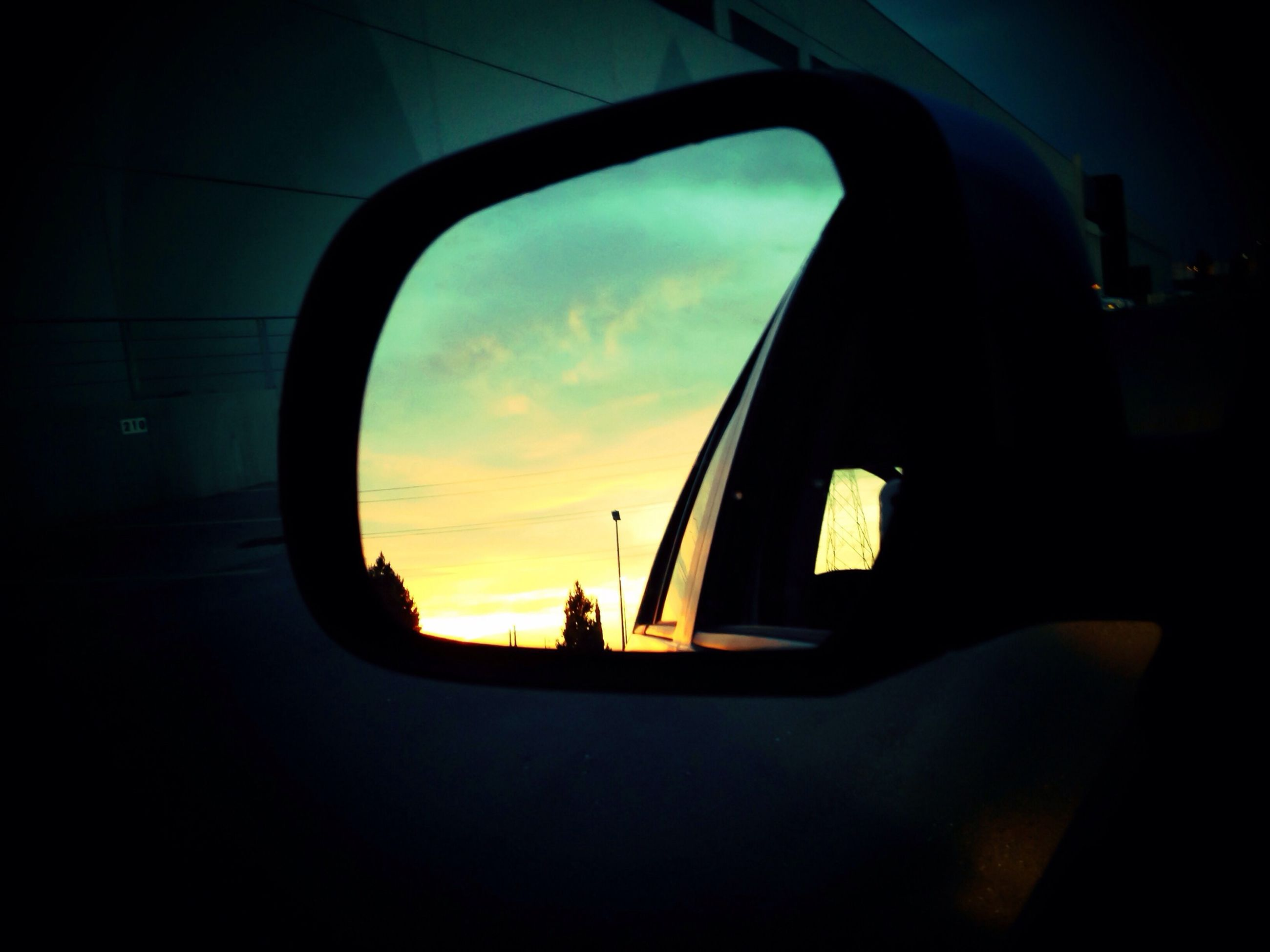 transportation, mode of transport, land vehicle, car, vehicle interior, sunset, sky, silhouette, travel, reflection, side-view mirror, on the move, window, glass - material, road, airplane, cloud - sky, car interior, journey, transparent