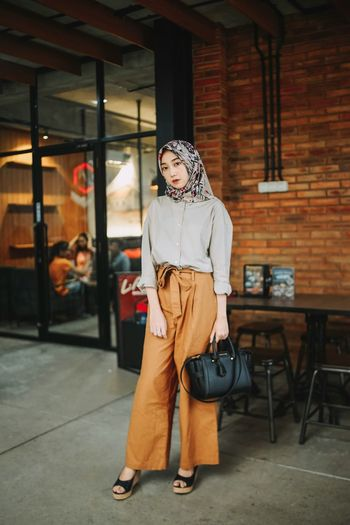 Portrait Of Young Woman Wearing Hijab In Cafe