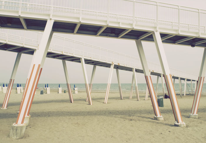 old pier complex at Lido of Venice Italy Off Season Pier Railing Tranquility Venice Lido Architecture Beach Day Deserted Empty End Of Summer Europe Italy Lido Low Season No People Outdoors Sand Sea Seafront Sky Structure Tranquil Scene