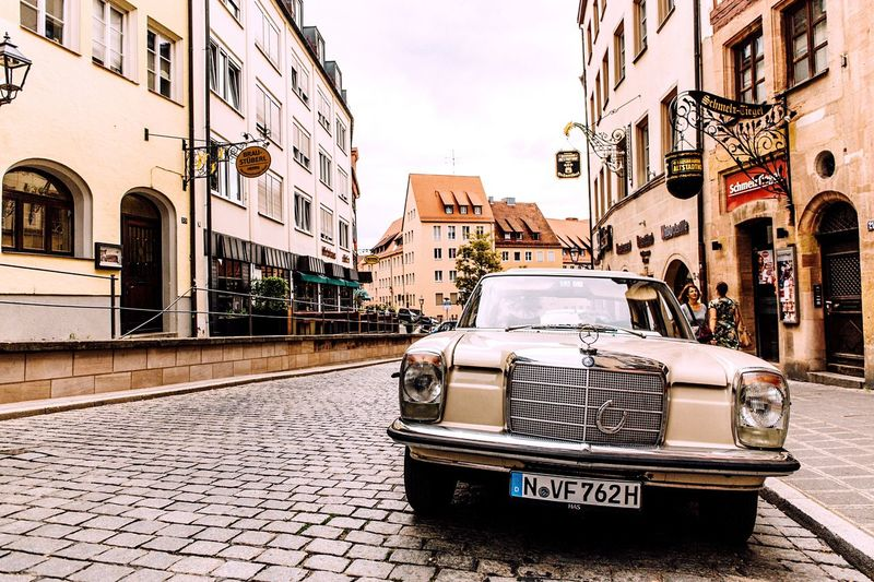 Building Exterior Architecture Built Structure City Transportation Mode Of Transport Outdoors Land Vehicle Day Snapshots Of Life Nuremberg Cityscapes City Germany Classic Car Classic No People