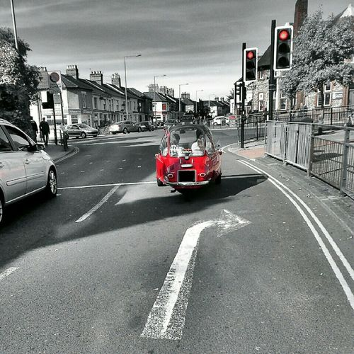 Red Bubble Car Splash Of Colour Traffic Lights Magdalen Street Norwich Vintage Car Rows Of Houses And Chimneys Taken From Smartphone Camera Taking Photos