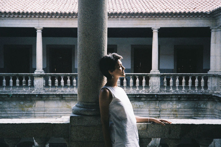Girl contemplating the cloisters of the convent on viseu