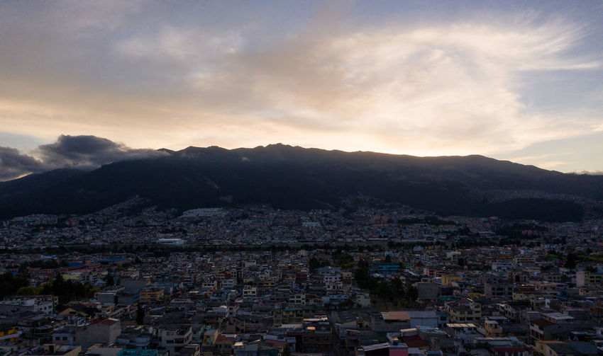 Andes Mountains Rucu Pichincha Architecture Building Building Exterior Built Structure City Cityscape Cloud - Sky Community Crowd Crowded High Angle View Mountain Mountain Range Nature Outdoors Residential District Settlement Sky Sunset Town TOWNSCAPE Urban Volcano