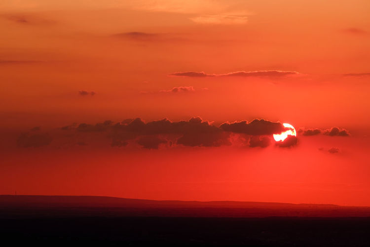 A beautiful sunset. Beauty In Nature Cloud - Sky Dramatic Sky Environment Idyllic Land Landscape Nature No People Non-urban Scene Orange Color Outdoors Romantic Sky Scenics - Nature Sea Silhouette Sky Sun Sunset Tranquil Scene Tranquility Water