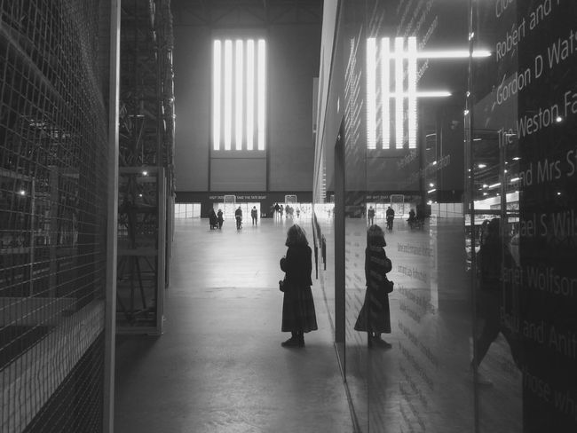 catching the reflections of passers by in the Tate Modern Architecture Black And White Full Length Indoors  Internal View People Real People Reflection Tate Modern Women