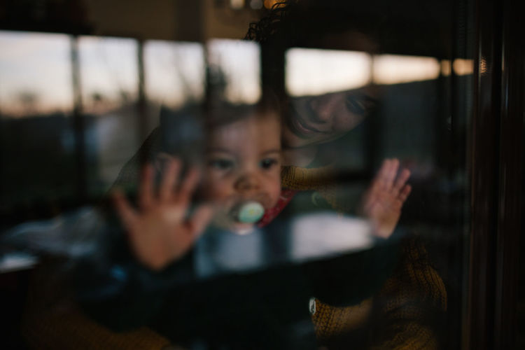 Through The Window Family Family With One Child Family Matters Looking Window Indoors  Childhood Portrait Child Emotion Innocence Hand Daughter Dark Women Offspring People Headshot Reflection Positive Emotion Love The Week On EyeEm Editor's Picks