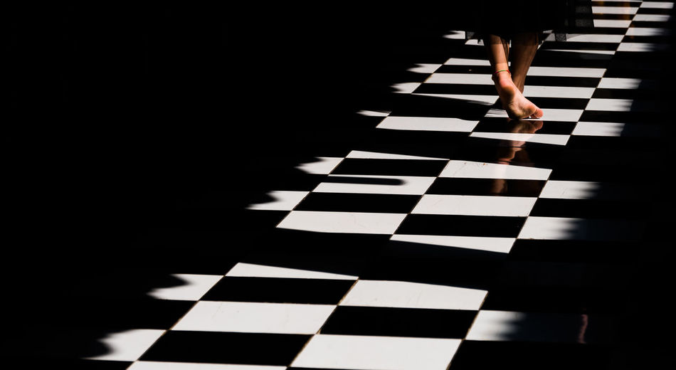 Lighting vs shadow One Person Indoors  Arts Culture And Entertainment White Color Pattern Checked Pattern Black Color Lifestyles Adult Body Part Motion Shadow Piano Key First Eyeem Photo Art Gallery EyeEm Best Shots EyeEm Gallery EyeEmBestPics Flame Light And Shadow Indoors  Building Fujifilm Fujifilm_xseries Architecture