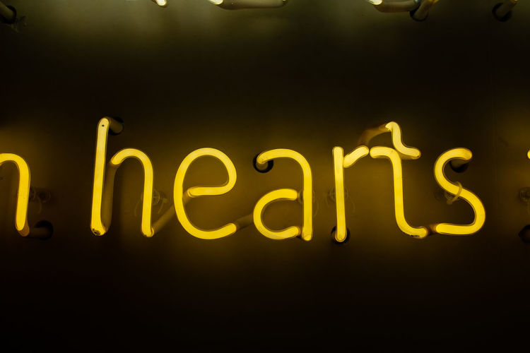 Text Illuminated Western Script Communication Night Neon Lighting Equipment Glowing No People Yellow Capital Letter Indoors  Close-up Light Wall - Building Feature Message Information Light - Natural Phenomenon Dark Sign Black Background Electric Lamp Neon Sign Heart