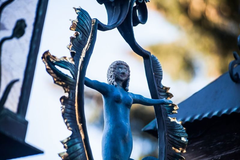 Close-up of statue against blue metal