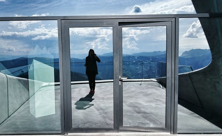Full length of woman standing on glass