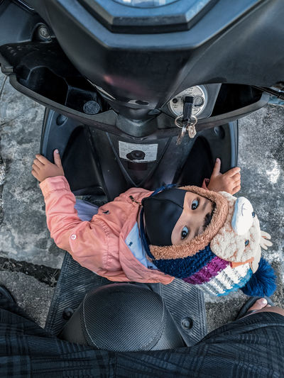 High angle portrait of woman in car