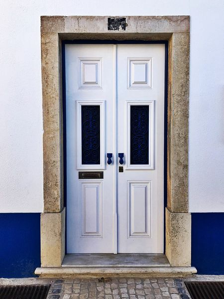 Typical blue of Ericeira Ericeira Portugal Architecture Blue Blueish Door Doors Lover Entrance Travel Destinations Typical Portuguese Architecture White