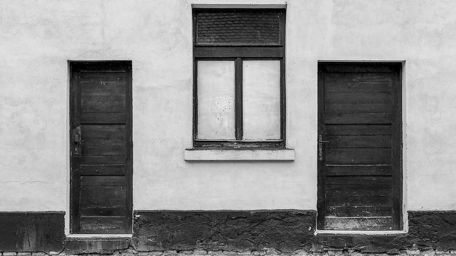 Architecture Black & White Black And White Bradley Olson Bradleywarren Photography Building Exterior Built Structure Dark And Light Day Door Doors Doorway Façade Geometric Shape Light And Dark Light And Darkness  Monochrome No People Old Old House Outdoors Symmetrical Symmetry Window Windows