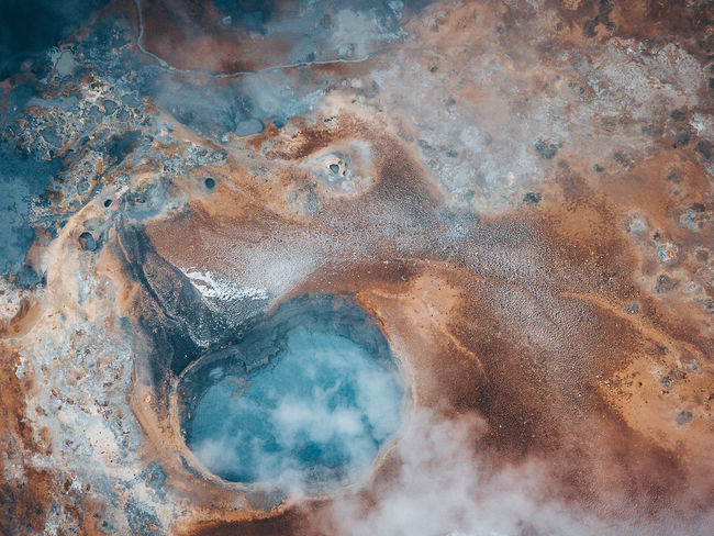Abstractions of nature. Iceland, Hverir geothermal spot noted for its bubbling pools of mud & steaming fumaroles emitting sulfuric gas. Aerial Shot Colors DJI Mavic Pro DJI X Eyeem Geothermal Fields Hot Myvatn Nature Abstract Abstractions Art Of Nature Backgrounds Beauty In Nature Close-up Cloud - Sky Day Digital Composite Environment Full Frame Geology Geyser Heat - Temperature High Angle View Hot Spring Hverir Iceland_collection Mavic Pro Mud Nature No People Outdoors Pattern Physical Geography Pool Shapes And Forms Smoke - Physical Structure Top Down View Tranquility Water