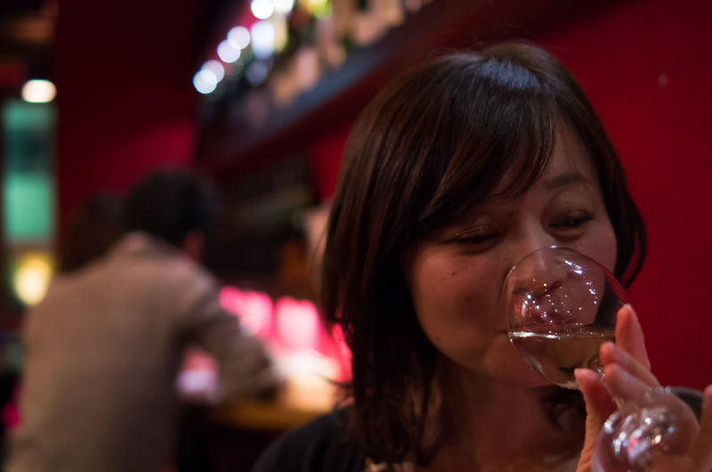 Woman drinking wine at bar