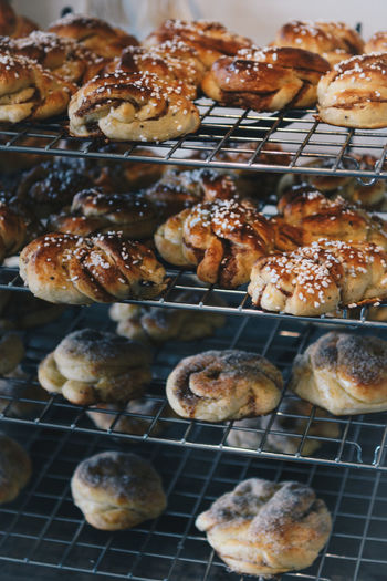 Cinnamon and cardamom buns Fika Food And Drink Heritage Food Swedish Bakery Baking Bun Cardamom Bun Cinnamon Cinnamon Bun Cinnamon Buns Close-up Cooling Rack Culture Food Food And Drink Freshness Indoors  Indulgence Interior Preparation  Rack Ready-to-eat Summer Temptation
