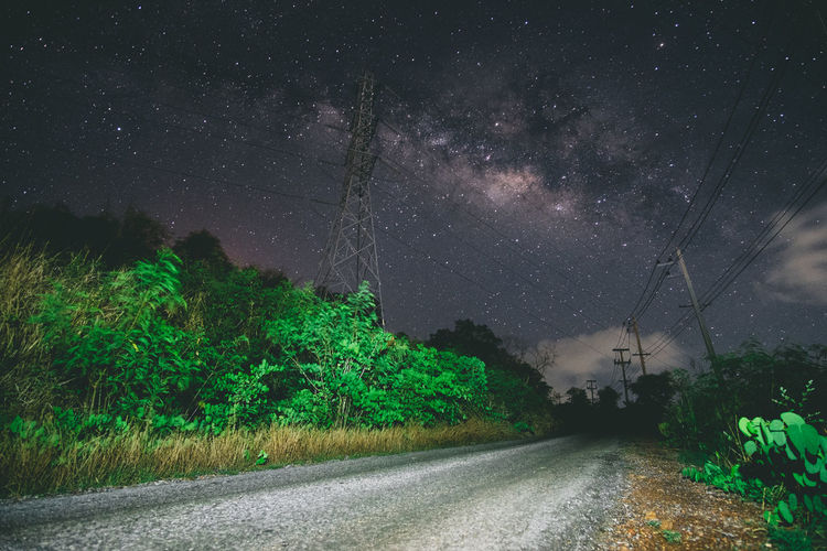 The Unexpected Encounter. We were doing our trail run starting midnight and I occasionally stop to take some shots. But then when I change my angle of view while doing long exposures, a peak of a sight of the milky way appeared on my shot. So I struggled to find a better angle to take the shot. Astronomy Astrophotography Beauty In Nature Constellation Electricity Pylon Eyeem Philippines Fujifilm Galaxy Milky Way Nature Night Night View Nightphotography Outdoors Road Rural Scene Samyang Sky Space Space And Astronomy Star - Space Star Field The Way Forward