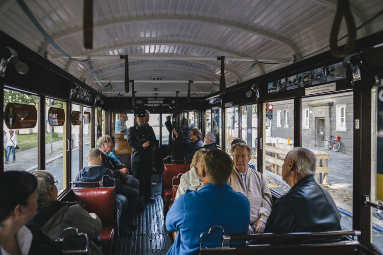 Group Of People Traveling In Tram