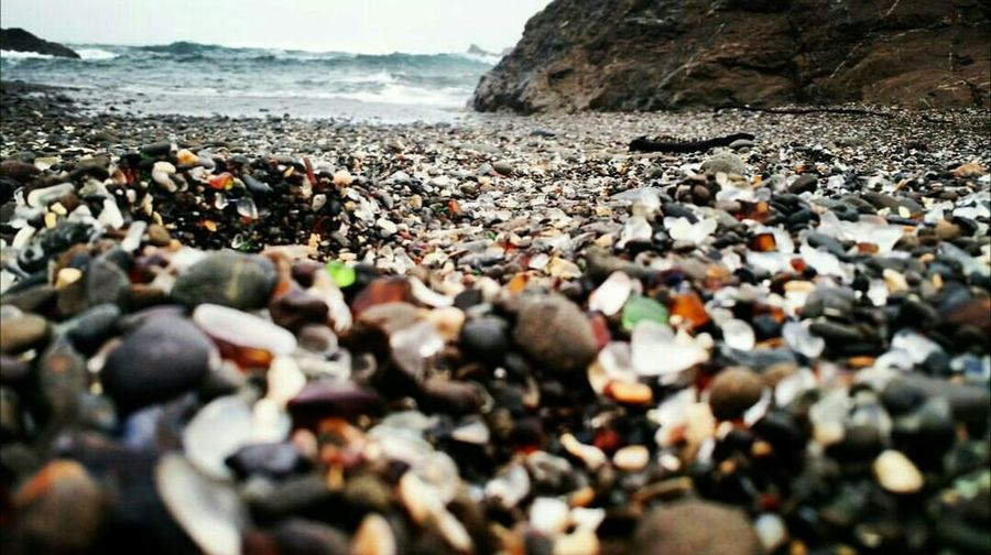 Glassbeach Shore Surface Level Pebble Sea Water Stone - Object Nature Abundance Tranquil Scene Coastline Pebble Beach Rocky Beauty In Nature Selective Focus Scenics Calm Outdoors Tranquility Day California Coast California Dreaming Caligraphy Cali Livin' California California Love Beach Shore Surface Level Pebble Sea Water Stone - Object Nature Abundance Tranquil Scene Coastline Pebble Beach Rocky Beauty In Nature Selective Focus Scenics Calm