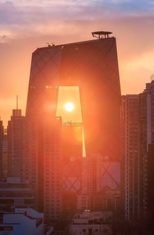 Paint The Town Yellow Sunset Architecture Sun Skyscraper Lens Flare City Building Exterior Built Structure No People Sky Cityscape Outdoors Modern Illuminated Day China Beijing