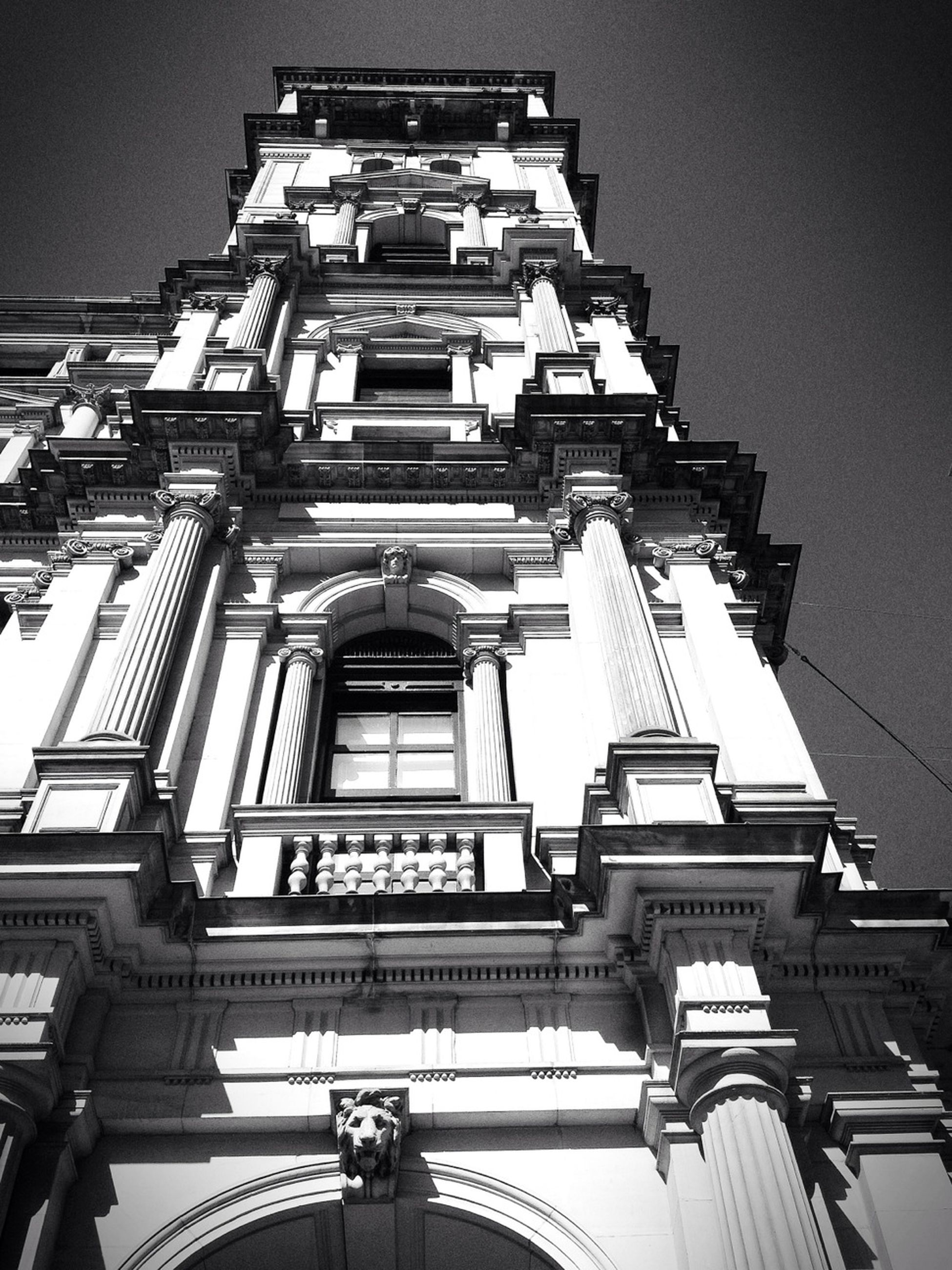 architecture, low angle view, built structure, building exterior, window, building, clear sky, architectural feature, city, facade, place of worship, sky, history, travel destinations, ornate, famous place, day, no people, outdoors, religion