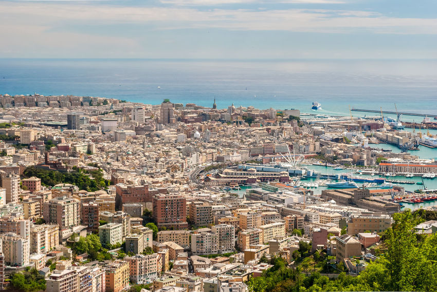 Aerial view of Genoa downtown seen from surrounding hills City Cityscape Downtown Genoa Genova Harbor Mediterranean  Panoramic Skyline Sunny Aerial Aerial View Buildings City Cityscape Italy Liguria Outdoors Sea Town Urban