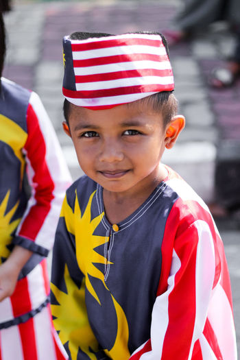 Kuala Terengganu, Malaysia - 31st August 2017: a boy wearing an attire that made up by Malaysian flag in a celebration. Jalur Gemilang Malaysia Merdeka Flag Malaysian Flag Boy Patriotism Love Country Child Childhood Smiling Looking At Camera Boys Patriotism Happiness Red Flag Thoughtful National Icon Striped