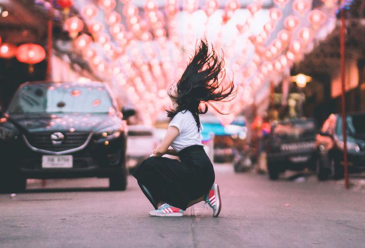 Full length of woman dancing outdoors